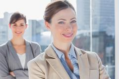 Stock Photo of Happy businesswomen with arms crossed