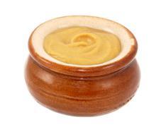 dijon mustard served in a small ceramic pot - stock photo
