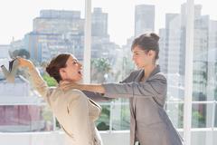 Businesswomen having a massive fight - stock photo