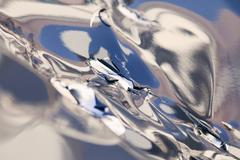 Abstract reflections on a silver surface Stock Photos