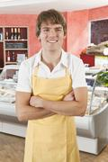 Portrait of a sales clerk in a gourmet delicatessen - stock photo