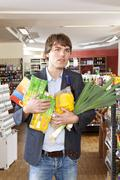 Stock Photo of A man with an armful of groceries