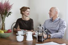 A mature couple having breakfast together Stock Photos