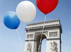 Balloons in the colors of the French flag in front of the Arc De Triomphe Stock Photos