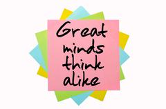 """proverb """"   great minds think alike """" written on bunch of sticky notes - stock photo"""