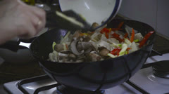 Stir fried chicken breasts with mushrooms in pan Stock Footage