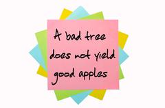 "Proverb ""a bad tree does not yield good apples"" written on bunch of sticky no Stock Photos"