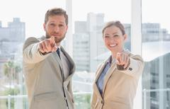 Stock Photo of Business team pointing at camera