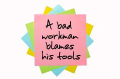 """proverb """"a bad workman blames his tools"""" written on bunch of sticky notes - stock illustration"""