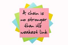 "proverb ""a chain is no stronger than its weakest link"" written on bunch of st - stock photo"