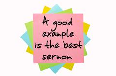 "proverb ""a good example is the best sermon"" written on bunch of sticky notes - stock photo"