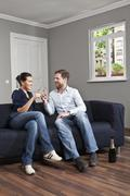 A couple toasting champagne flutes at home Stock Photos