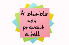 "proverb ""a stumble may prevent a fall"" written on bunch of sticky notes - stock photo"
