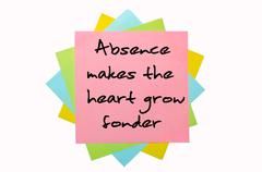 "Proverb ""absence makes the heart grow fonder"" written on bunch of sticky note Stock Photos"