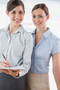 Young businesswomen smiling at camera - stock photo