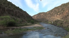 Stunning hot air balloon drops into Rio Grande Gorge Taos New Mexico Stock Footage