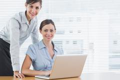 Stock Photo of Businesswomen smiling at the camera