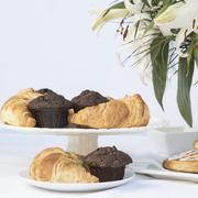 Continental breakfast table setting with pastries and cakes Stock Photos