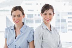 Businesswomen smiling at camera - stock photo
