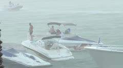 Boaters in Rainstorm - stock footage