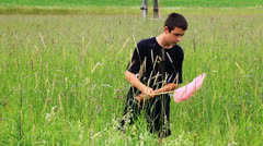 Stock Video Footage of Boy catching butterflies in the meadow