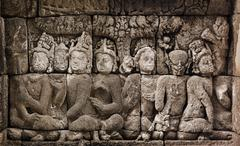 Stock Photo of buddhist carved relief at medieval borobudur temple on java, indonesia