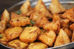 Stock Photo of traditional indian dish samosa on the open market