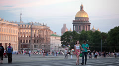 Loving couple walking on Palace Square in Saint-Petersburg - stock footage