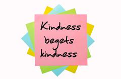 "proverb "" kindness begets kindness "" written on bunch of sticky notes - stock photo"