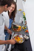 Man cooking vegetables - stock photo