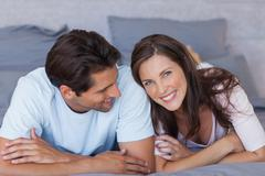 Stock Photo of Lovely couple lying on bed