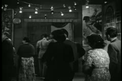 Latecomers entering theater,  1940s Stock Footage