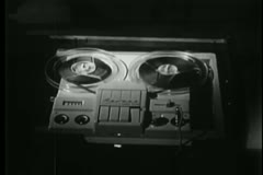 Close-up of  reel to reel tape recorder playing Stock Footage
