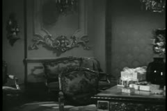Panning room with wrapped gift boxes on table, 1940s Stock Footage