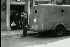 Men in uniform carrying money bags into Brinks truck Stock Footage