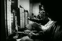 Side view of telephone operators working in police department Stock Footage