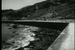 Car speeding into Fort Point,  San Francisco, California Stock Footage