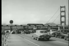 Car avoiding toll booth, San Francisco, California, 1950s Stock Footage