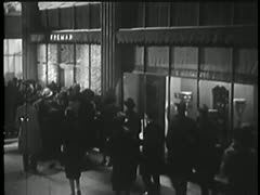 Policemen rushing through crowd and into building Stock Footage