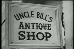 Close-up of  Uncle Bill''s Antique Shop sign Stock Footage