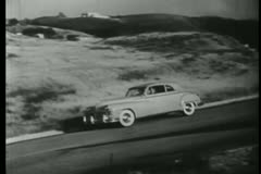Car traveling along California coast, 1940s Stock Footage