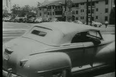 Vintage cars following each other on city street, Los Angeles, California Stock Footage