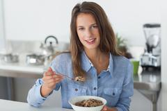 Stock Photo of Attractive woman eating cereal
