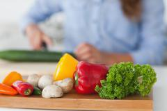 Wooden board with vegetables on a table Stock Photos