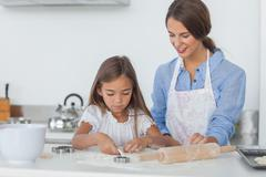 Stock Photo of Mother and daughter baking together