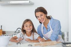 Stock Photo of Portrait of mother and daughter baking together