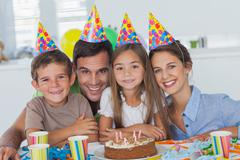 Beautiful family celebrating a party - stock photo