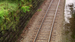 Railroad stonewall greenery Stock Footage