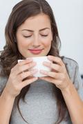 Woman waking with the scent of coffee - stock photo