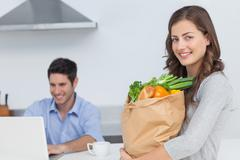 Woman holding groceries bag Stock Photos